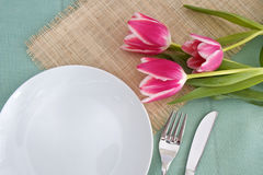 Table place setting with flowers Stock Photos