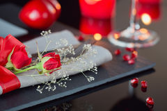 Table place setting with holidays decoration. Royalty Free Stock Images