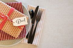 Table Place Setting for a Man or Boy for a Birthday Party or Father`s Day Celebration Dinner and background room or space for copy