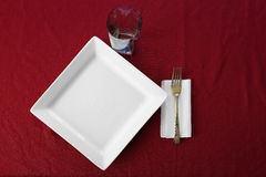 Table Place Setting Plate Cup Fork Red Tablecloth Royalty Free Stock Images