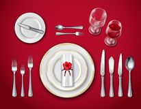 Table Place Setting On Red. Top view of table place setting for ceremonial dinner on red background with empty plate glasses and cutlery realistic vector stock illustration