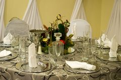 Wedding Place Setting, Cater, Catering. Table place setting for a wedding reception and party. A caterer who does catering and food and beverage services will stock photos