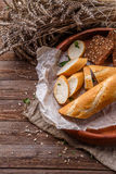 Table with plate of bread Stock Photography