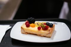 On the table is a plate with cheesecake. royalty free stock photography