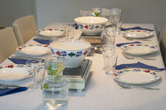 Table with plates and bowls Stock Photos
