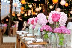 Table With Plates and Flowers Filed Neatly Selective Focus Photography Stock Photo