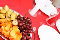 Table with plates and fruits Stock Image
