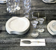 Table with plates and glasses Royalty Free Stock Photos