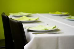 Table with plates and napkins Stock Photo