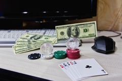 Table player online casino chips, cards and coins cryptocurrency bitcoin stock photos