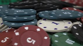 Table With Poker Chips Turns In Casino.Poker Chips For Gambling Card Game stock footage