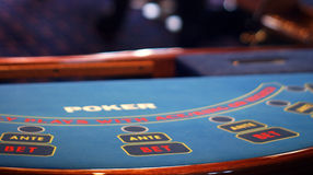Table poker details. Poker table blue - bet and ante in focus royalty free stock photo