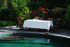 Table by the pool. Breakfast table by the pool in a hotel in Bali Stock Photos