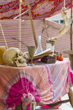 Table with potions and skull Stock Photos