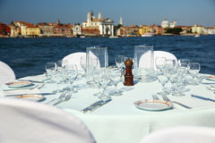 Table prepared with the stunning backdrop of Venice Stock Image