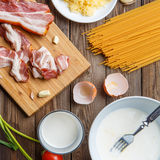 On table preparing pasta carbonara. In brown wooden table preparing pasta carbonara stock photography