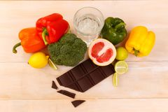 On a table, products for weight loss and bitter dark chocolate chocolate. royalty free stock images