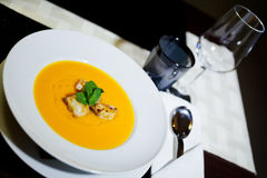 Pumpkin soup. The table with pumpkin soup Royalty Free Stock Photo