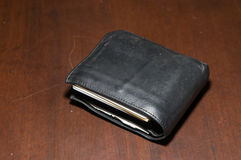 Table purse with money Stock Image