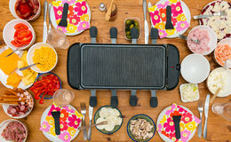 Table with raclette Stock Images