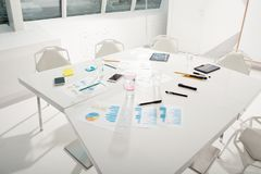 Table reading for business meeting with company statistics Royalty Free Stock Images