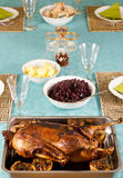 Table ready laid with goose Stock Photo