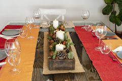 Table ready to eat with a Christmas center. royalty free stock photos