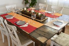 Table ready to eat with a Christmas center. Table ready to eat with a Christmas center, red tablecloth and blue dishes stock image