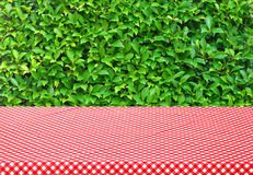 Table with red tablecloth and trees background Stock Photo