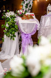 Table for the registration of marriage. A table for registering the marriage with purple ribbons Royalty Free Stock Photo