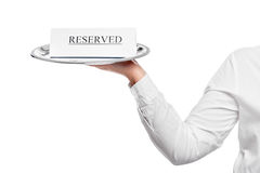 Table reservation in a restaurant advert on tray Stock Photo