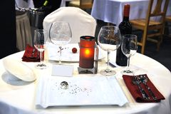 Table  at restaurant. Table layout at restaurant. Tablewares and wine Royalty Free Stock Image