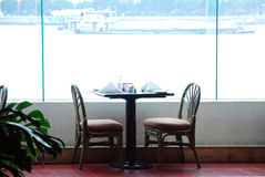 Table in the restaurant. With large window Stock Photos