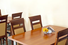 Table in restaurant. Close up of a simple wooden table and chairs in a restaurant Stock Photo