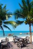 Table in a restaurant on the beach Stock Photos