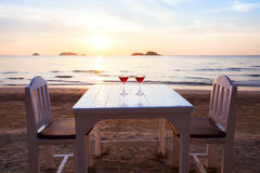 Table in restaurant on the beach Royalty Free Stock Images