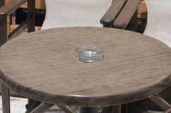 Table in restaurant with empty ashtray Royalty Free Stock Images
