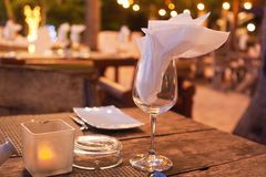 Table in the restaurant with a glass and cutlery Stock Images