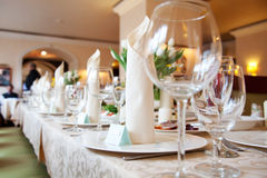 Table in a restaurant with glasses and napkins Royalty Free Stock Images