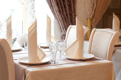 Table in restaurant with napkin, decor. Beige. Royalty Free Stock Image