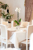 Table in restaurant with napkin, decor and lily. Beige. Decor in restaurant Stock Photo