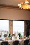 A table in a restaurant near the sea Royalty Free Stock Photos
