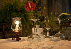Dinner Table restaurant. Out side table restaurant with red exotic flower in the center of Florence... ready for clients in this summer evening Royalty Free Stock Image