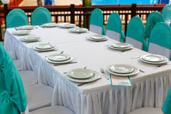Table in the restaurant with plates Stock Images