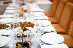 Table in a restaurant is ready for banquet Royalty Free Stock Photography
