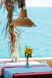 Table in a restaurant by the sea. Royalty Free Stock Images
