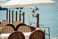 Table in a restaurant by the sea. Royalty Free Stock Image
