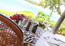 Table in the restaurant on the sea background Stock Images