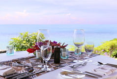 Table in the restaurant on the sea background Royalty Free Stock Photos