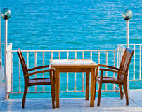 Table in a restaurant with sea view Royalty Free Stock Images